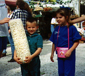 [kids with popcorn bags]